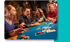Group laughing playing Poker