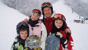 Family with Snowboard Gear